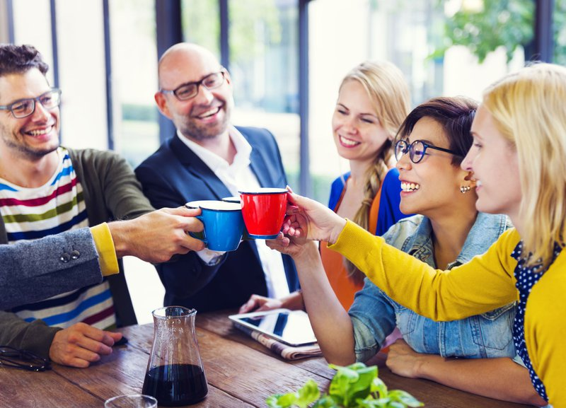 Five friends networking over coffee