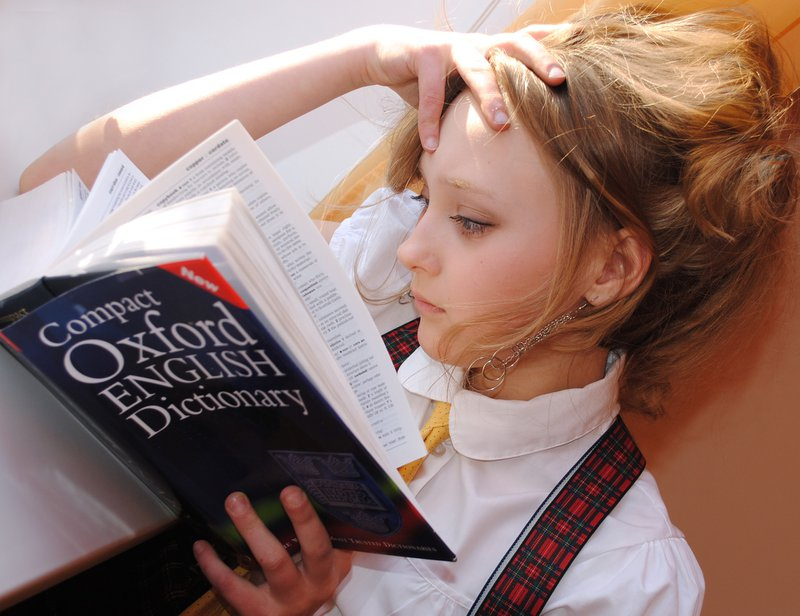 A girl reading dictionary