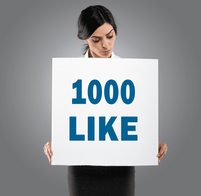 "Woman holding a ""1000 like"" poster"