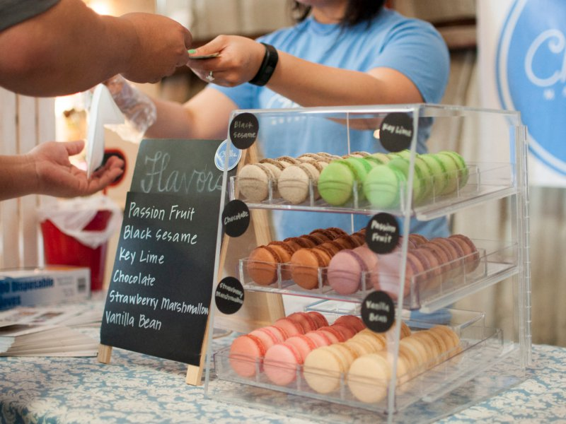 Woman buying macaroons
