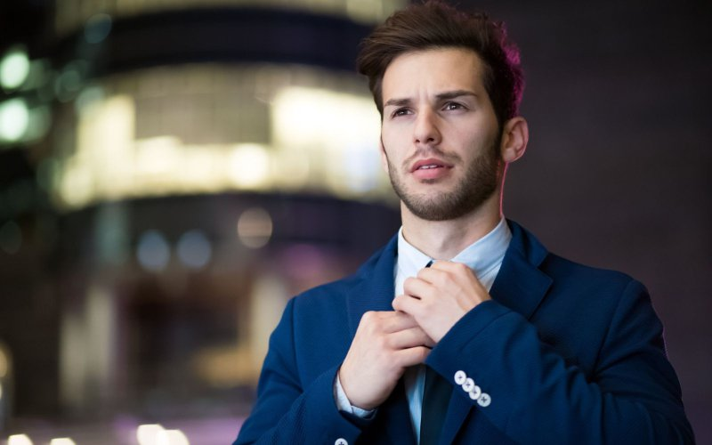 How to get promoted- image of a professional adjusting his tie