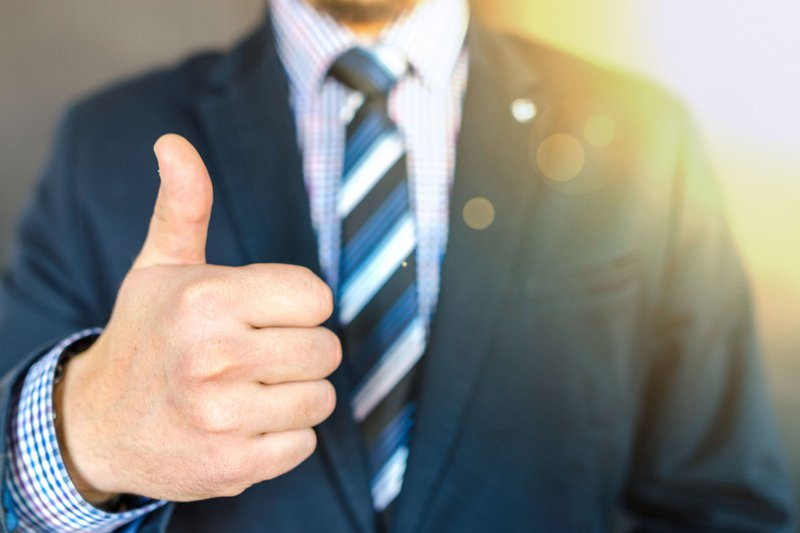 A professional showing thumbs up when avoid things not to say at work