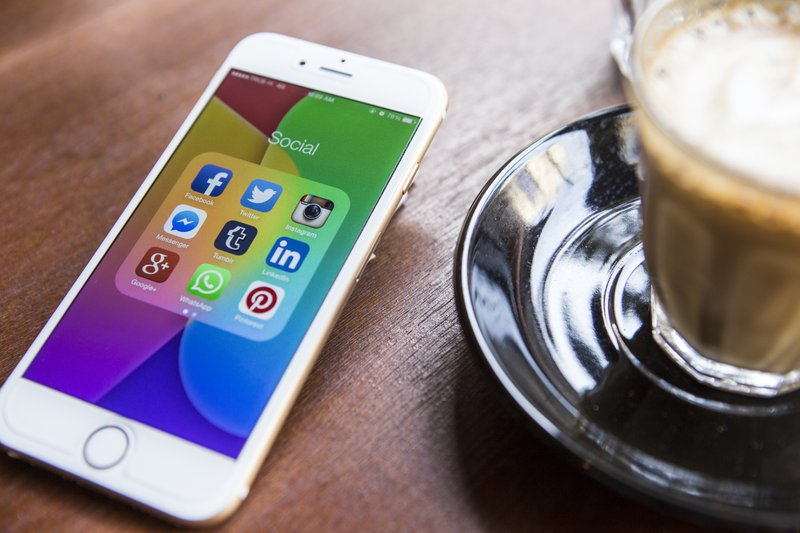 A mobile phone screen with various social media apps' thumbnails