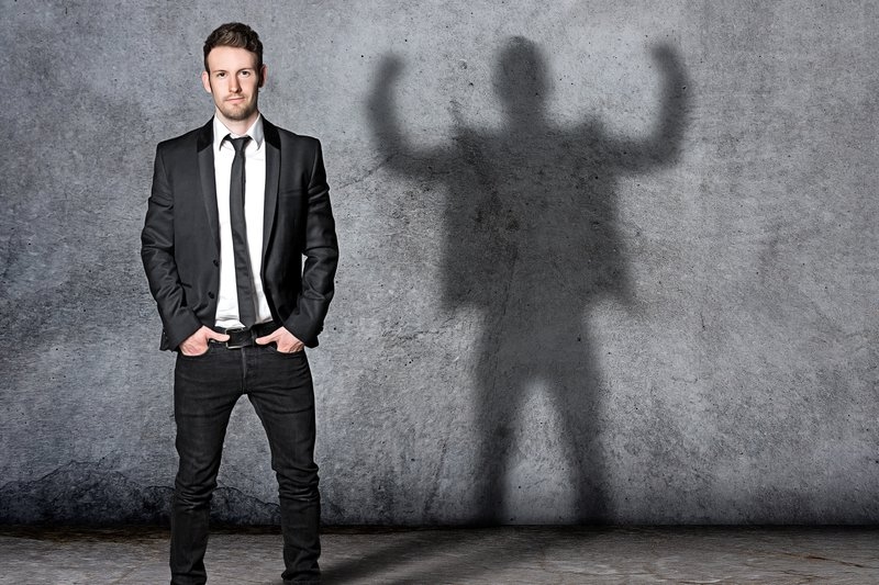 A professional standing next to his shadow