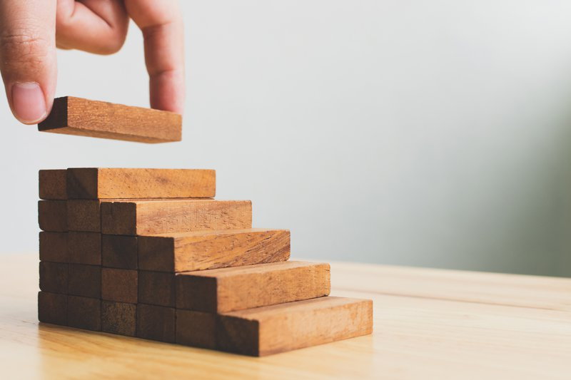 A hand keeping a stair block on a staircase