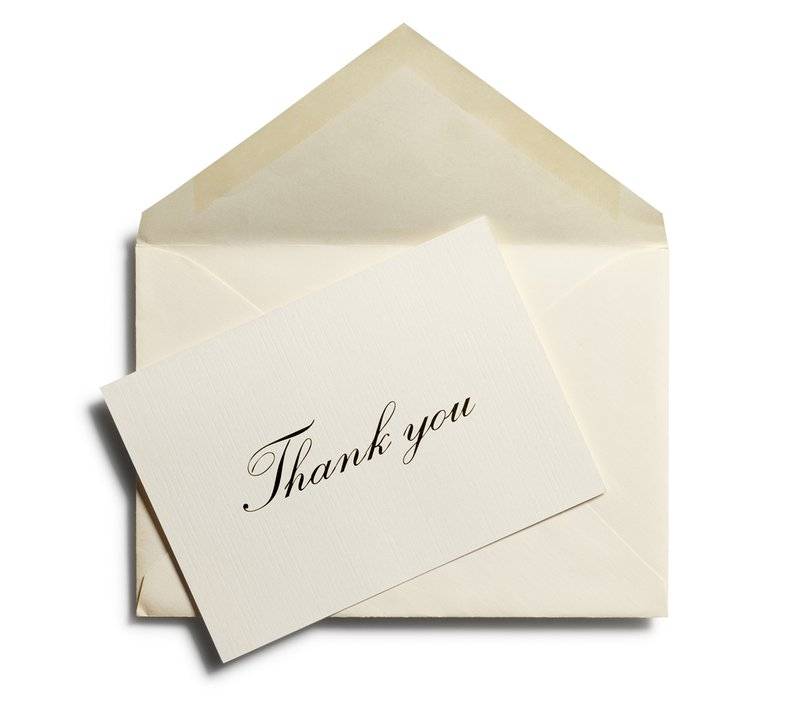 A professional thank you note against an open envelope isolated