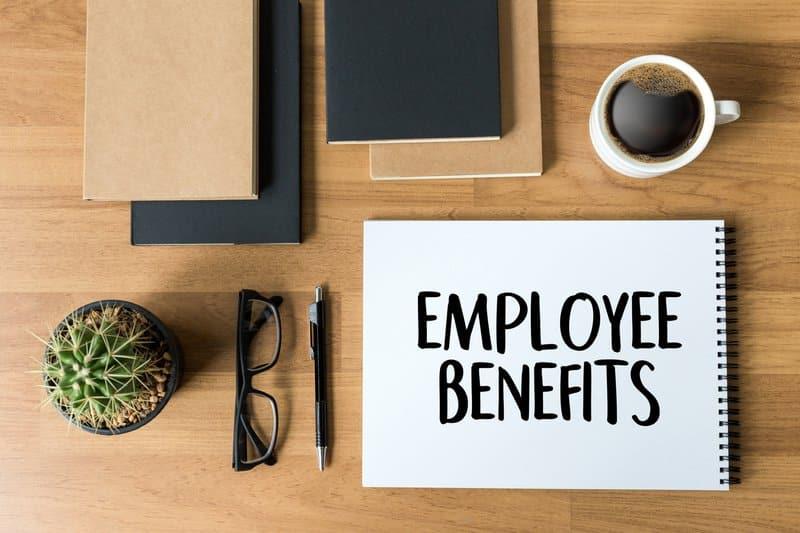 Employee benefits written on a notepad
