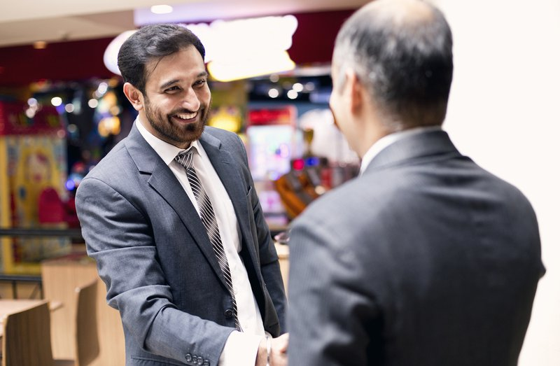 Two professionals handshaking