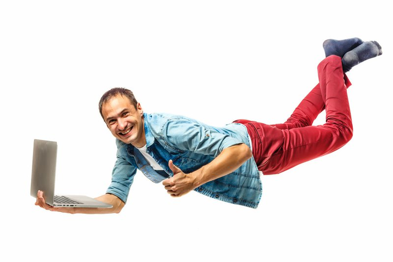 Young hipster man with laptop in the air. isolated on white. Concept communication.