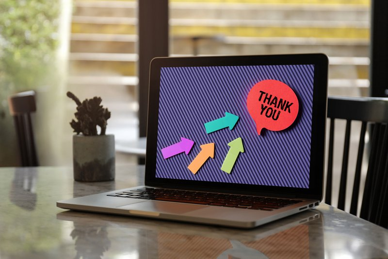 Thank You on laptop screen