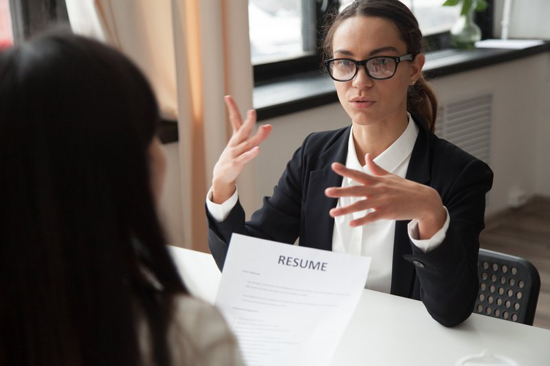 A female applicant talking at job fair with the recruiter