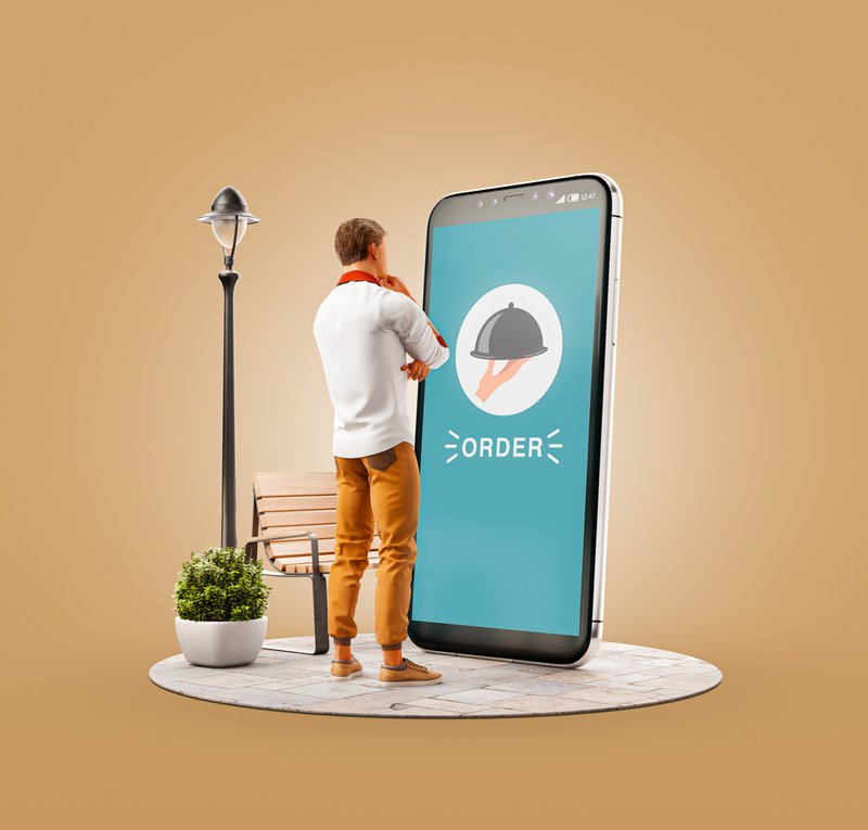 A man standing in front of 3D illustration of a smart phone application