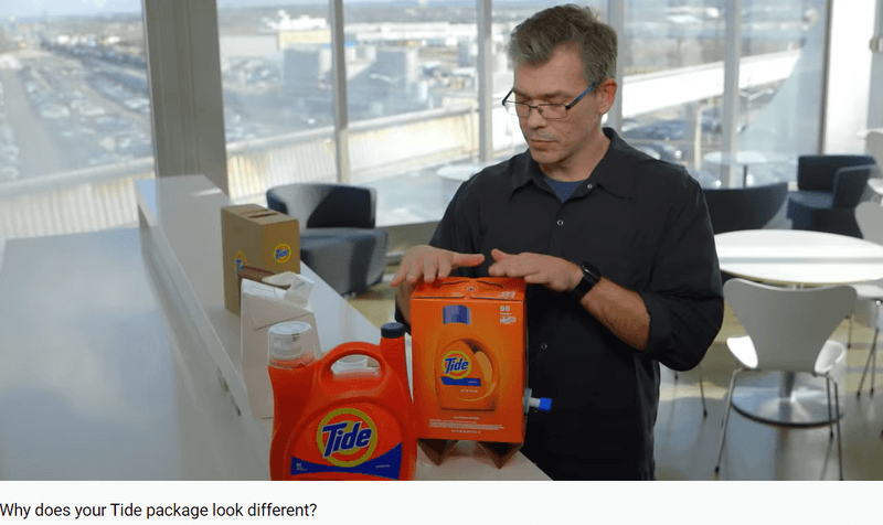 A man with Tide plastic packaging and new box packaging