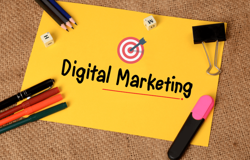 Digital Marketing with Target Icon on paper