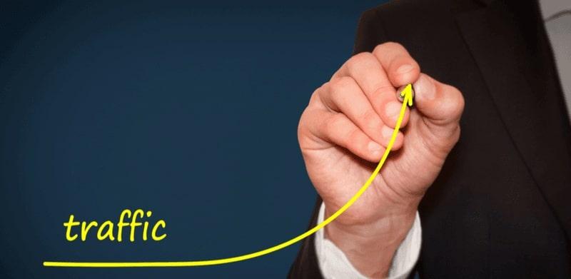 Businessman draw growing line symbolize growing website traffic