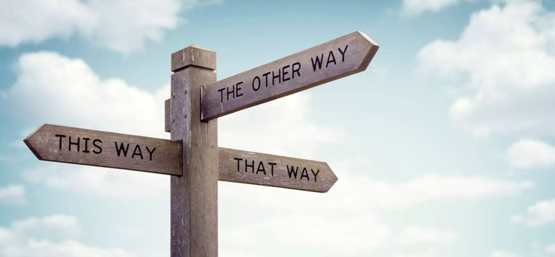 Which way to go road sign: A marketing consultant sets a direction for businesses
