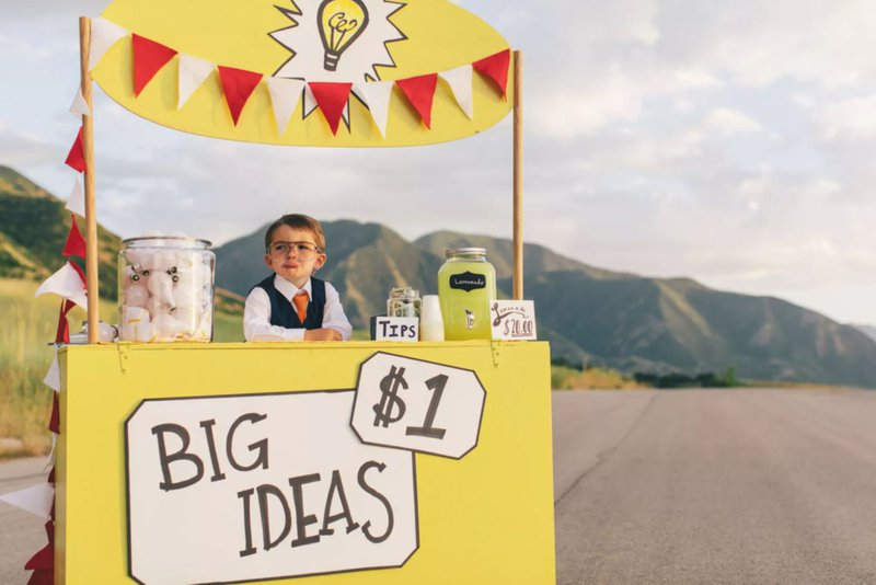 Young Business Boy Runs Big Idea Stand