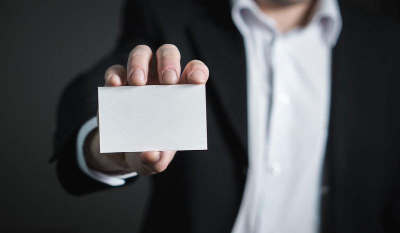 Professional with a blank business card
