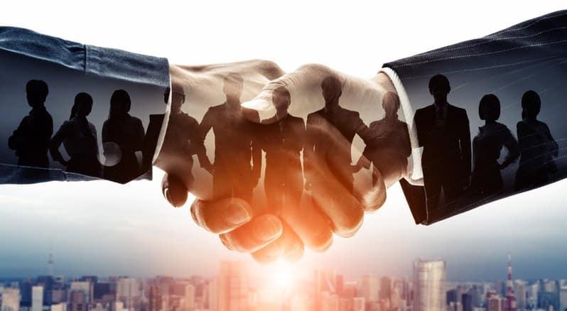Two business people handshaking
