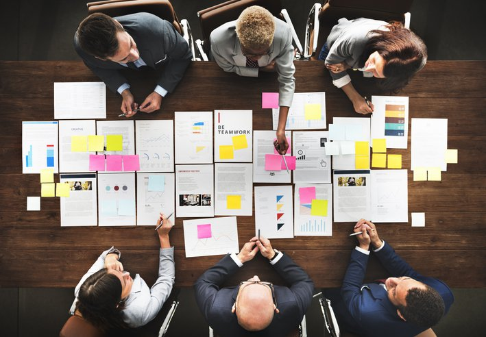 Business people analyzing marketing management data