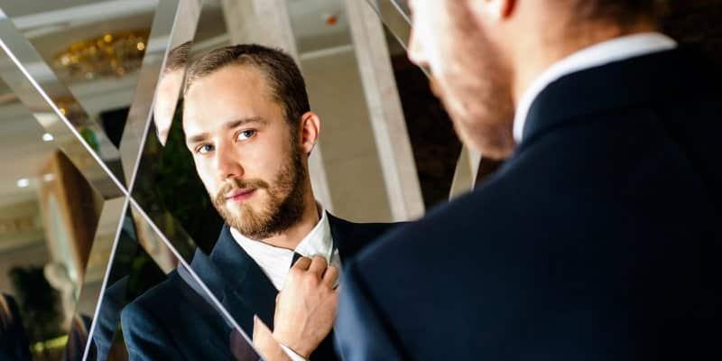 A professional adjusting his tie.