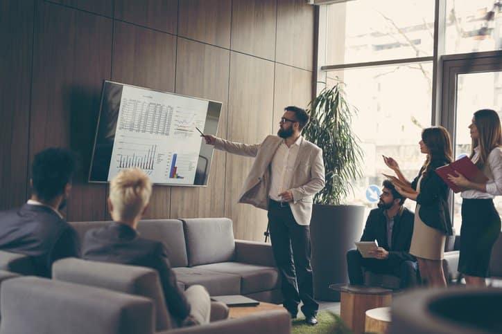 A sales consultant presenting to sales representatives