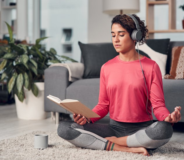 Woman doing yoga and reading her book