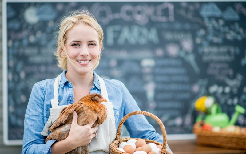 A woman with consumer non-durables like eggs and chicken