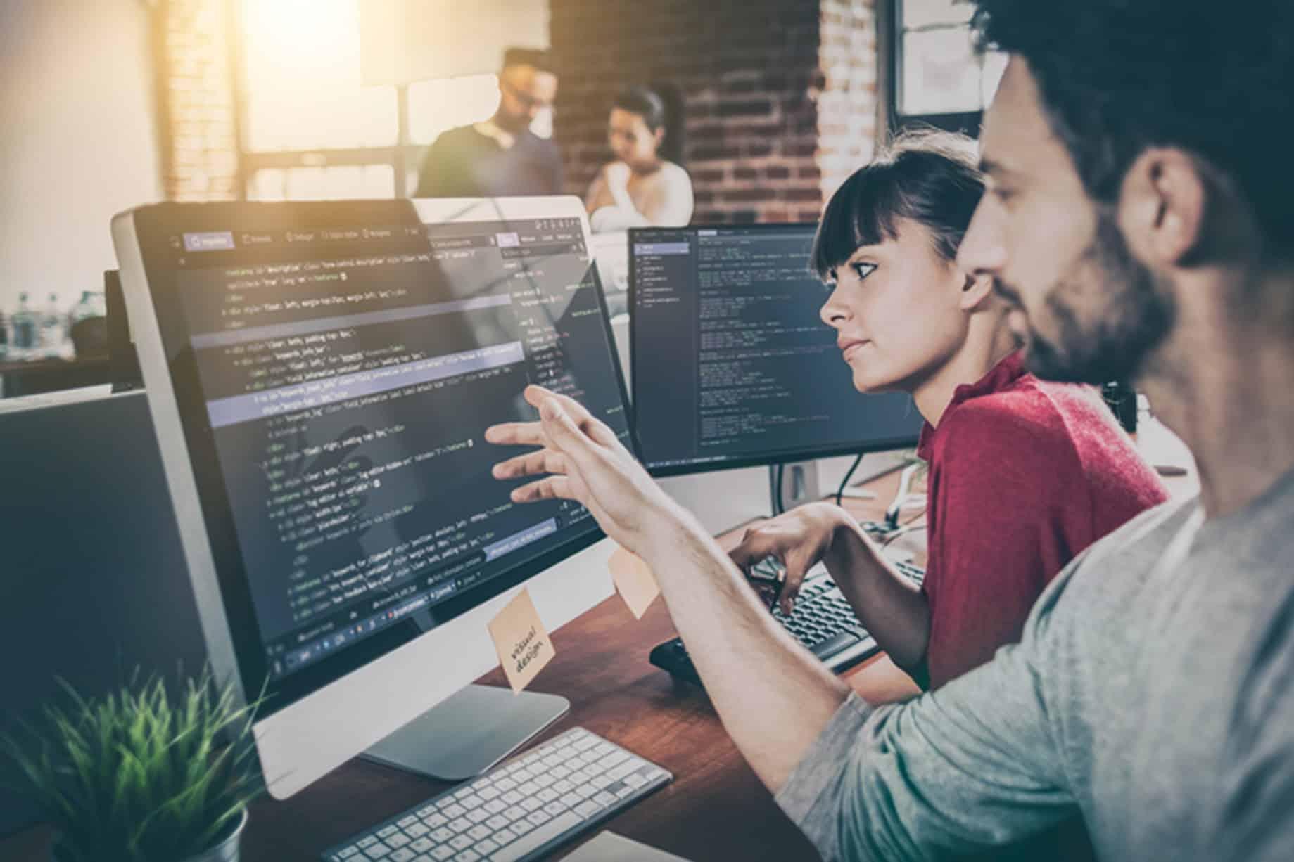 A Lead Developer presenting his code in a computer
