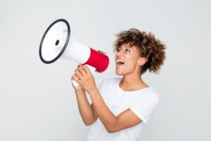 African woman making an announcement with megaphone