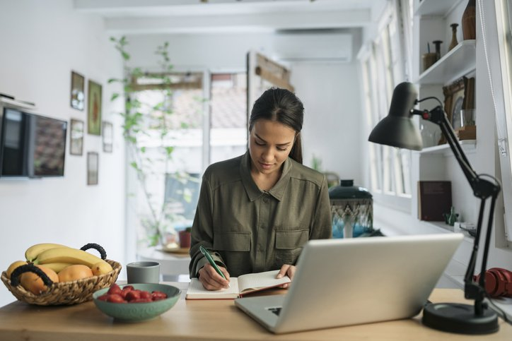 Woman writing her professional background