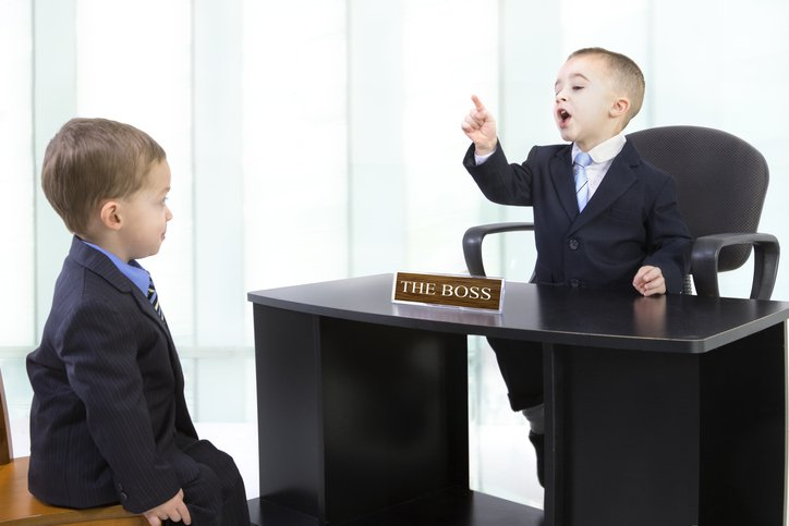 A kid enacting a boss to a fireable employee