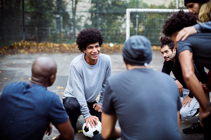 A football team leader with his teammates
